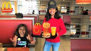 Kids pretend play working at McDonald