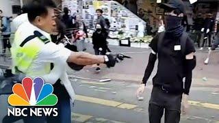 Hong Kong Police Officer Shoots Protester At Close Range | NBC News