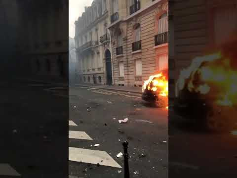 Paris Protesters Set Cars On Fire .