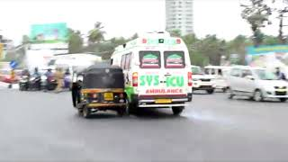 Ambulance rams bike riders at traffic signal