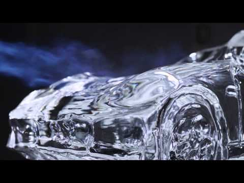 Mesmerising Video Of A Man Melting A Car's Ice Sculpture On Reverse