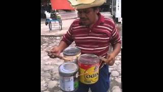 Man with Music Cans
