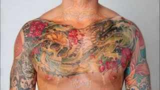The Twenty Coolest Tattoos In WWE History Slide Show