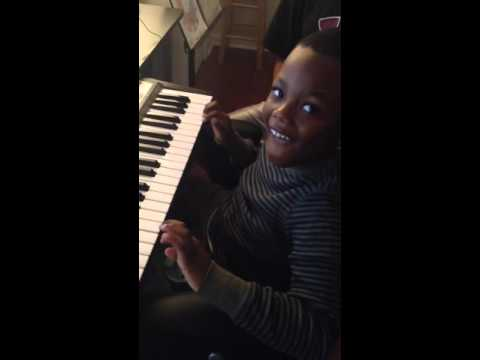 One of my first and youngest students, Jaydon. He is practicing playing the ABC song.