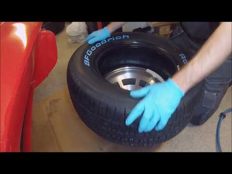 Mounting new tire by hand