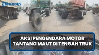 Viral Aksi Pengendara Motor di Cilincing Tantang Maut di Tengah Truk, Disebut Prank Malaikat Maut