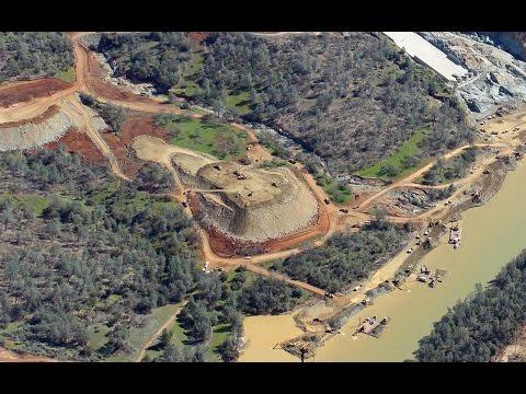 Trucks hauling boulders to Oroville Dam Spillway - Naijafy