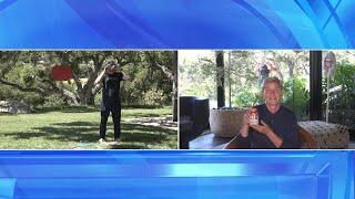 Andy Attempts to Break Open a Piñata in Ellen's Backyard