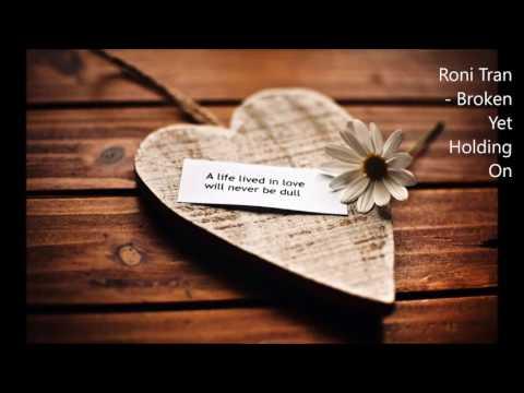 Roni Tran - Broken Yet Holding On (Lyrics)