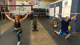 Becky Lynch shows a WWE Universe member how she does CrossFit