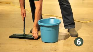 Cleaning a Rubio floor with a buffer