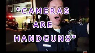 POLICE CLAIM CAMERA'S ARE NOW HANDGUNS