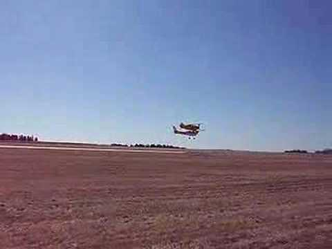 Low pass Pitts and Cessna 150 tailwheel at Brookings, SD Fly-IN