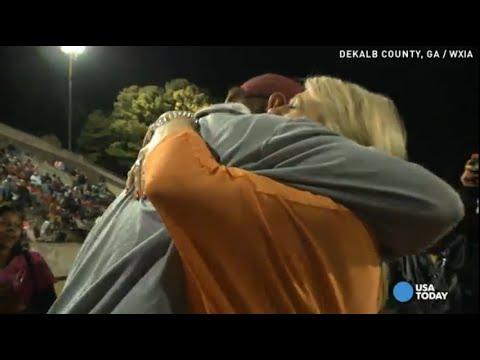 Wife's surprise brings veteran football coach to tears