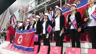 Supporters of North Korea are singing the national anthem before the game against Saudi Arabia