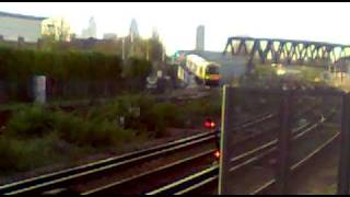 preview picture of video 'London Overground train on the New Cross Gate flyover'