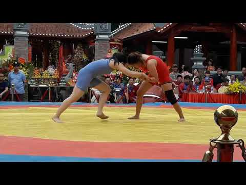 girls fighting wrestling in an open square
