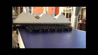 Système de dépoussiérage avec aspiration et convoyeur modulaire