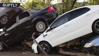 'Domino effect': Dozens of vehicles pile up in row after mudflows sweep Crimea town