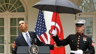 King Obama Calls Marines To Hold His Umbrella