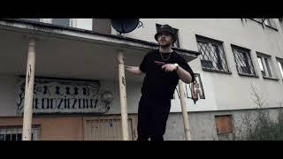 Kadr z teledysku Włóczęga tekst piosenki Kaz Bałagane feat. CatchUp