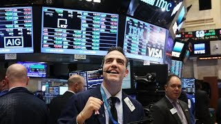 DOW JONES INDUSTRIAL AVERAGE Dow Jones Industrial Average Tops 21,000 for First Time