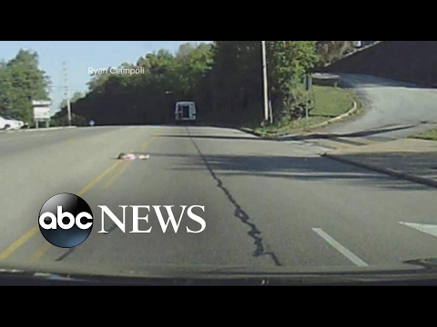 Young child falls out of the back of a church bus onto the highway