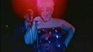 Divine and me dancing on stage at The Hacienda