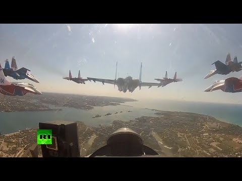 Watch A First-Person View Of Nine Jet Fighters Flying In Perfect Formation