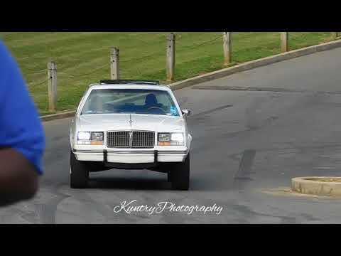 White Bonneville on color match dub wheels. mtown ryder 5 video shoot. Memphis whips