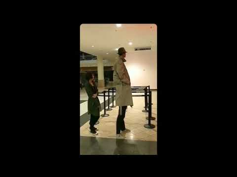 two kids dressed as a tall man to get into