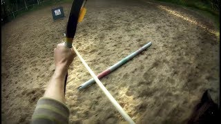 Horseback archery holding the arrows in the bow hand filmed with helmet camera
