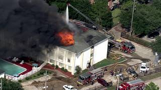 Raw video: Firefighters battle massive fire at Motel 6 in Spring, Texas