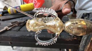 Glass artist Manolo Aguilera creates a traditional Venetian goblet with gold leaf