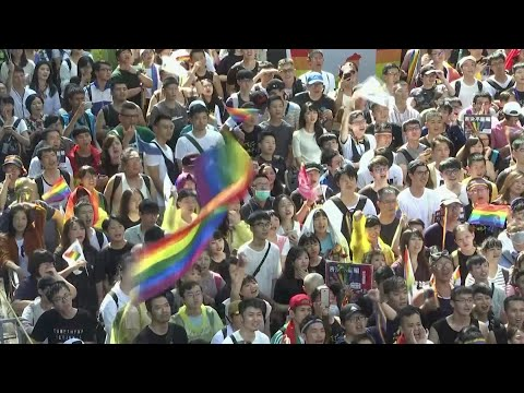 Taiwan's legislature voted Friday to legalize same-sex marriage, a first in Asia and a boost for LGBT rights activists who had championed the cause for two decades. (May 17)