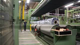 Packing textile rolls in plastic