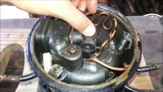 Desmontando um motor/compressor de geladeira