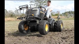 Putting Big Front Tires and Wheels on a Mower.