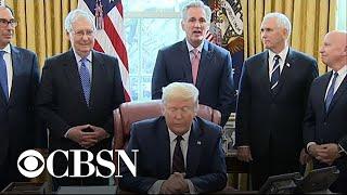 Trump signs $2 trillion coronavirus relief package