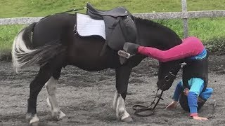Gentle Pony Helps Girl Who Falls Off After Fence Jump