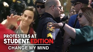 Crazy MAGA-Hat Stealing Protester Shut Down by Cops!   Change My Mind