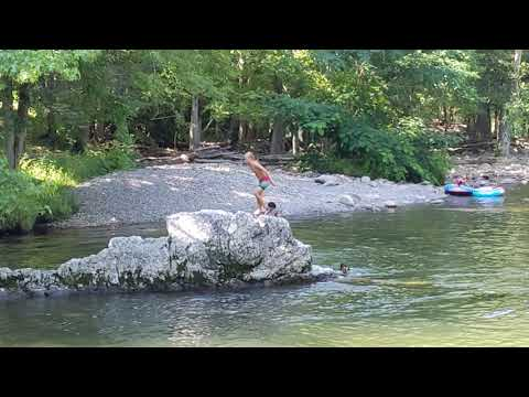 Kids jumping from rock at beach area