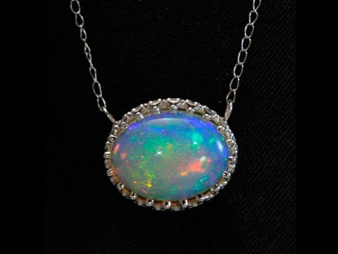 Opal Pendant in !4 Karat White Gold