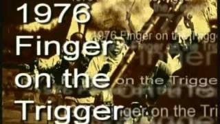 1976 Finger on the trigger