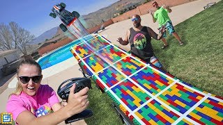 JUMPING my RC TRUCK over my SWIMMING POOL GIANT LEGO MEGA BLOCKS JUMP!