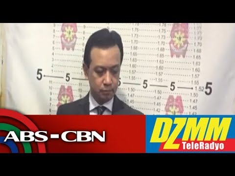 [ABS-CBN]  Trillanes undergoes booking procedure, to post bail at Makati RTC