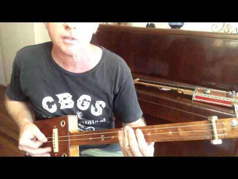 How to play Folsom Prison Blues on a 3 string slide cigar box guitar by Nigel McTrustry