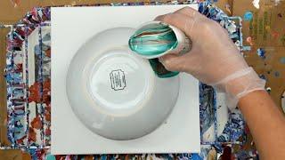 Fluid Art On A Ceramic Bowl With A Canvas Underneath
