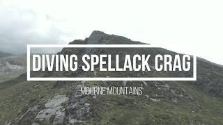 DJI FPV diving Spellack Crag cliff face.