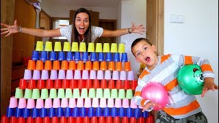 Liam Pretend Play stacking GAME with GIANT Cup Wall